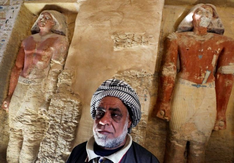 """An Egyptian archaeological worker stands inside the newly-discovered tomb of """"Wahtye"""", which dates from the rule of King Neferirkare Kakai, at the Saqqara area near its necropolis, in Giza, Egypt, December 15, 2018."""