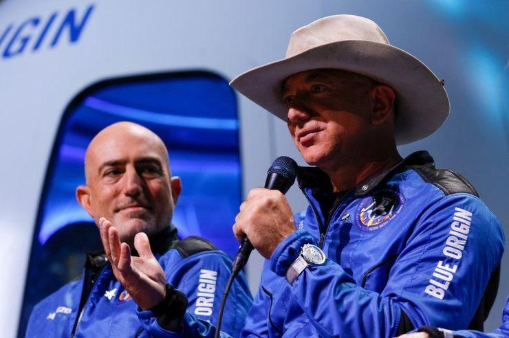 Mark Bezos (L) and Jeff Bezos