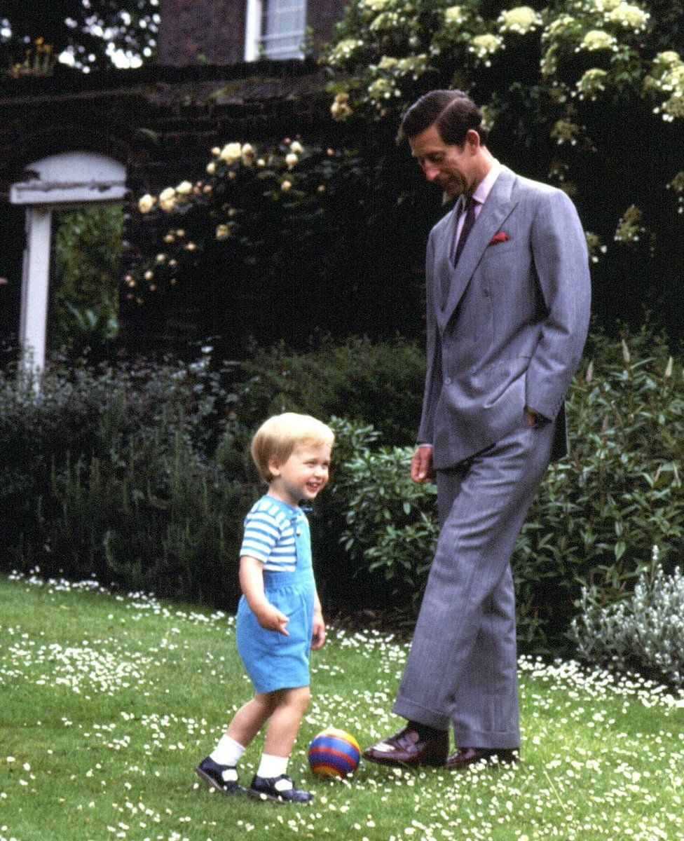 Prince of Wales and Prince William playing in the garden of Kensington Palace, London.