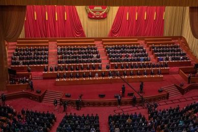 Chinese President Xi Jinping, Premier Li Keqiang and other delegates attend the closing session of the National People's Congress (NPC), at the Great Hall of the People, in Beijing, China, 11 March 2021.
