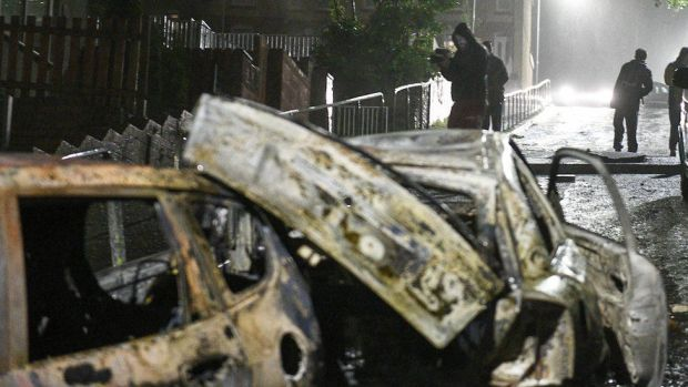 Cars burnt out in the streets