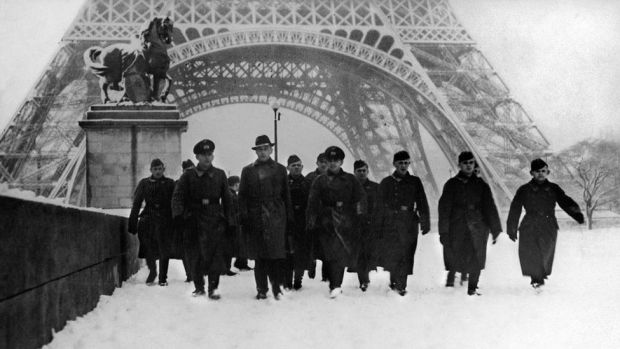 German Soldiers Cross The Iena Bridge, Covered In Snow, In Front Of The Eiffel Tower In Paris in January 1941