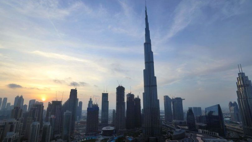 The skyline of Dubai and the high Burj Khalifa are pictured at sunset on February 9, 2021