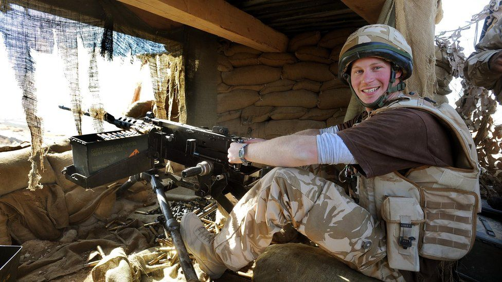 Prince Harry with a machine gun