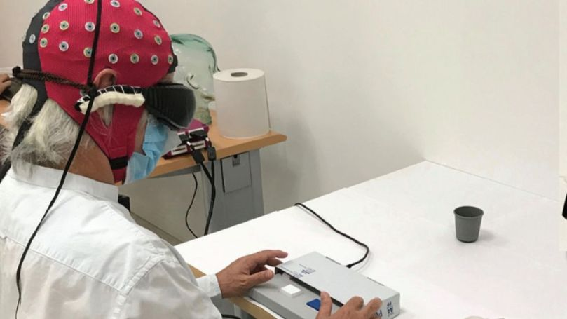 The patient undergoing tests in the lab
