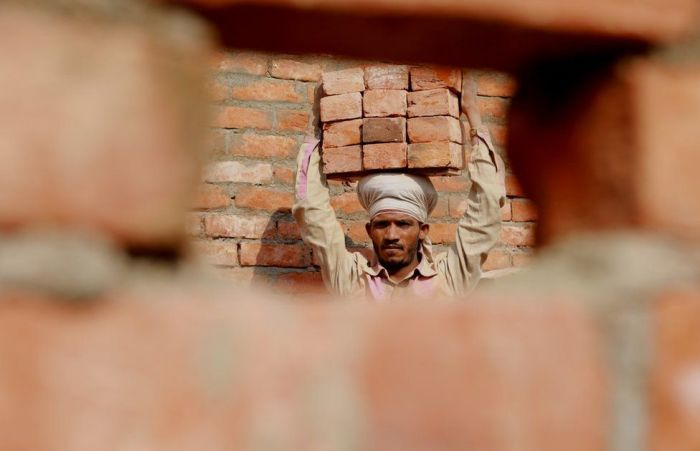 Ram Bhavan at a construction site carrying bricks