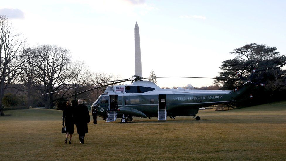 Donald Trump and first lady Melania Trump depart the White House to board Marine One