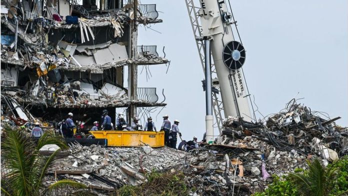 Search and Rescue teams look for possible survivors in the partially collapsed 12-story Champlain Towers South condo building on June 29, 2021 in Surfside, Florida.