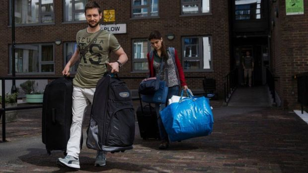 Camden residents leaving with their belongings