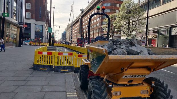 Construction work and digger on Oxford Street