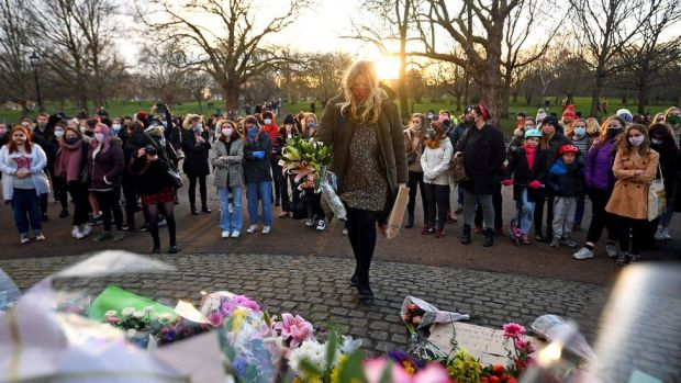 People gather at a memorial at Clapham Common