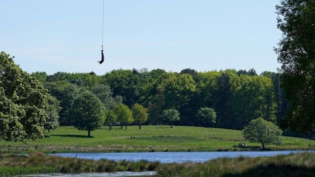 A person bungee jumps in Tatton Park, Knutsford, Cheshire on Sunday