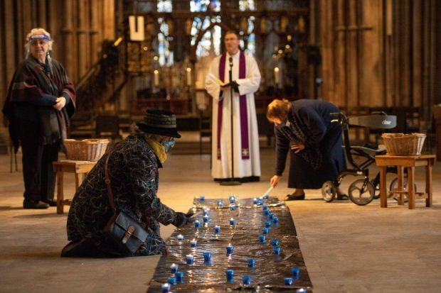 People light candles on the floor of Lichfield Cathedral