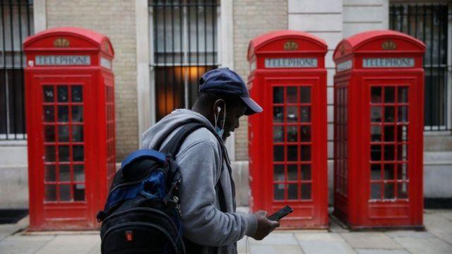Man walking looking at his phone