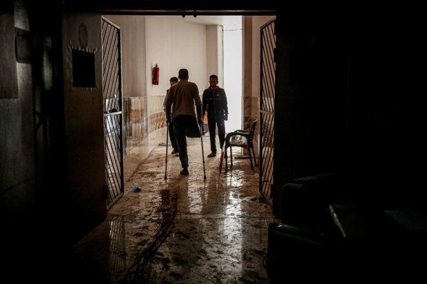 Syrians inspect damage inside a hospital in Atarib district in Idlib de-escalation zone, western Aleppo, Syria on 22 March 22 2021