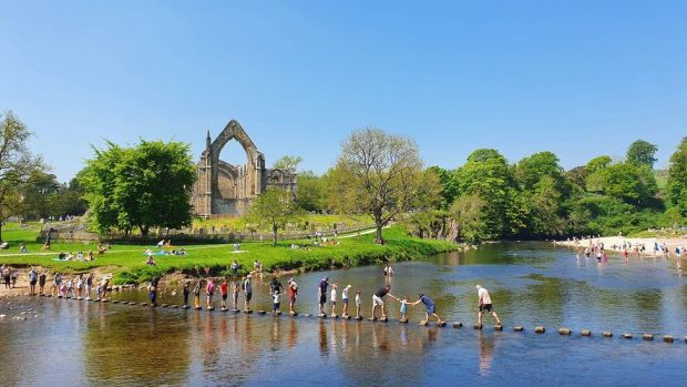 People enjoy the sunshine at Bolton Abbey in Yorkshire on Bank Holiday Monday