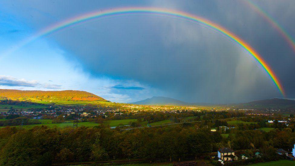 Deri, Skirrid Fawr, Skirrid Fach and rainbows.  Photo by Tony Dandridge