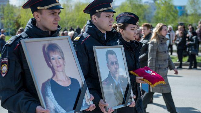 Похороны полицейского Андрея Гошта и его семьи
