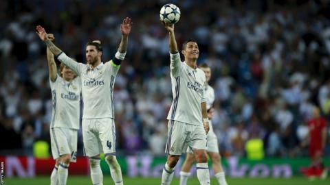 Cristiano Ronaldo shows off the matchball after hitting three figures in the Champions League