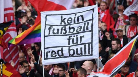 sport Bayern Munich fans hold a banner reading: 'Kein fussball fur Red Bull' (no football for Red Bull)