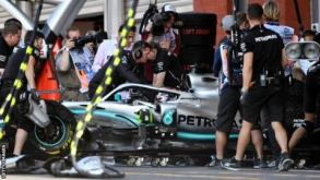 Hamilton goes back into the pits after problems early on in practice