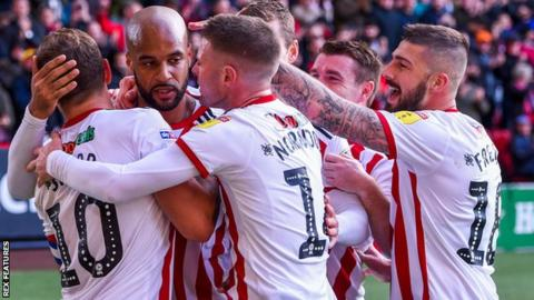 David McGoldrick (second from left) celebrates the goal that sent Sheffield United top of the Championship