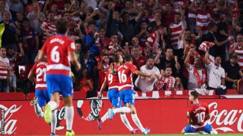 Granada celebrate scoring against Barcelona