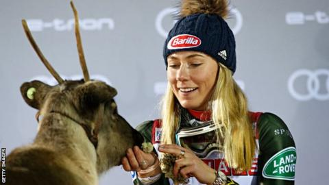 sport Mikaela Shiffrin and a reindeer