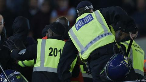 Riot police and stewards at West Ham v Chelsea