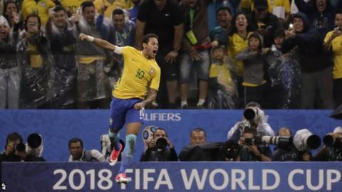 Neymar celebrates scoring for Brazil