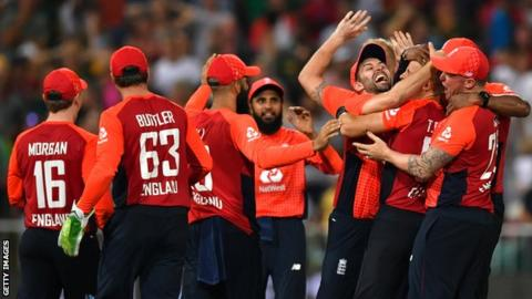 England celebrate their two-run win over South Africa in the second T20