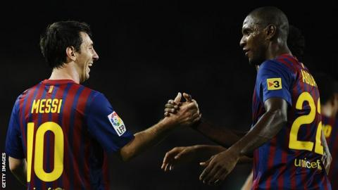 sport Lionel Messi and Eric Abidal