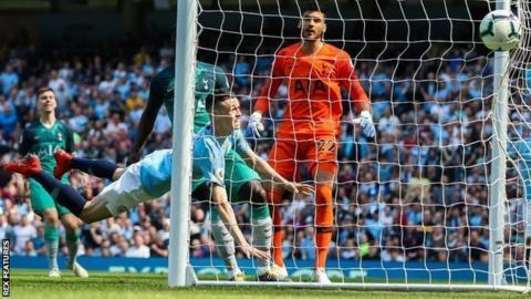 Phil Foden scores for Manchester City against Tottenham Hotspur in a Premier League game
