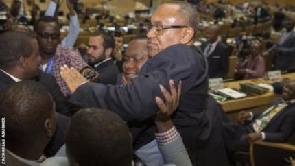New Caf president Ahmad is held aloft