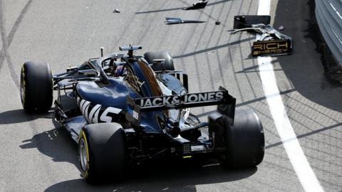 Romain Grosjean crashes in the pit lane
