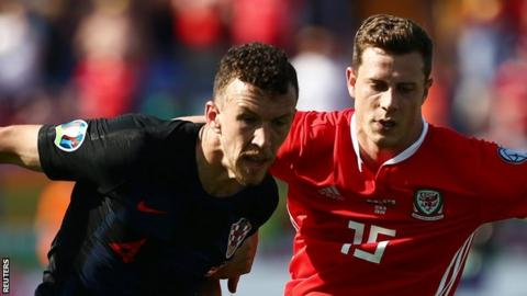 Croatia winger Ivan Perisic (left) in action against Wales
