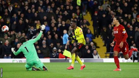 Watford's Ismaila Sarr chips over Liverpool's Alisson