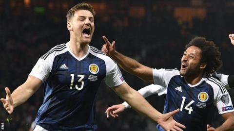 Chris Martin celebrates scoring Scotland's late winner against Slovenia