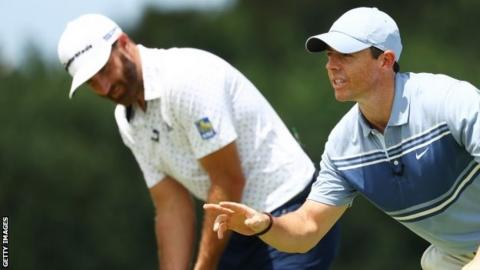 Dustin Johnson (left) and Rory McIlroy