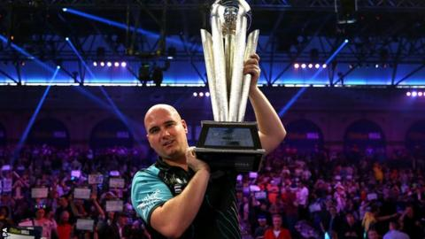 Rob Cross celebrates his world title