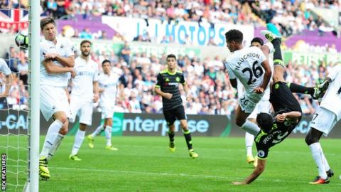 Chelsea striker Diego Costa scores an overhead kick against Swansea to earn his side a 2-2 draw