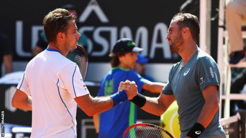 Stan Wawrinka (left) and Steve Johnson shaking hands at the net
