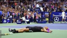 Rafael Nadal falls to the ground after winning