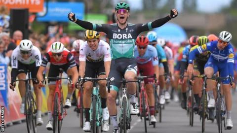 Sam Bennett celebrates winning stage three of the 2019 Criterium du Dauphine