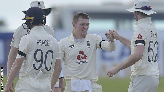 England's Dom Bess celebrates with Dom Sibley after taking a wicket against Sri Lanka