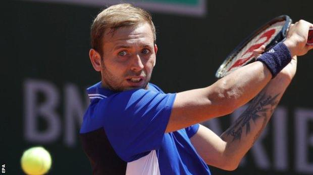 Dan Evans returns in his French Open first-round match