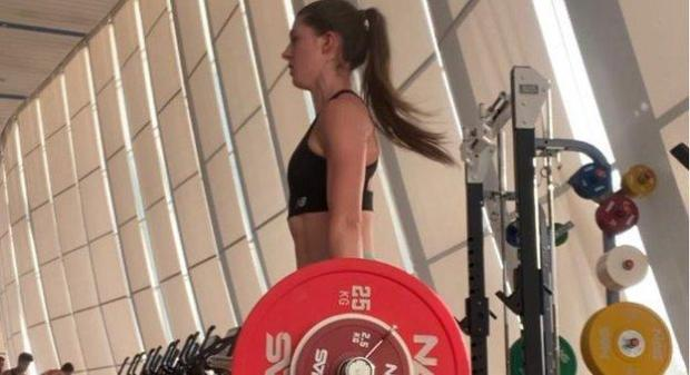 Amy Hunt lifting weights in Dubai