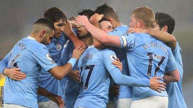 Manchester City celebrate scoring against Brighton