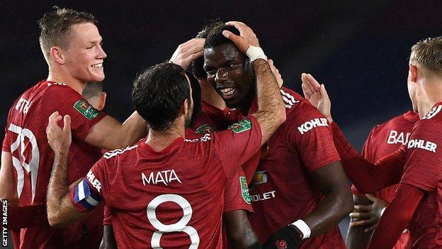 Paul Pogba (centre) congratulated by team-mates after scoring at Brighton