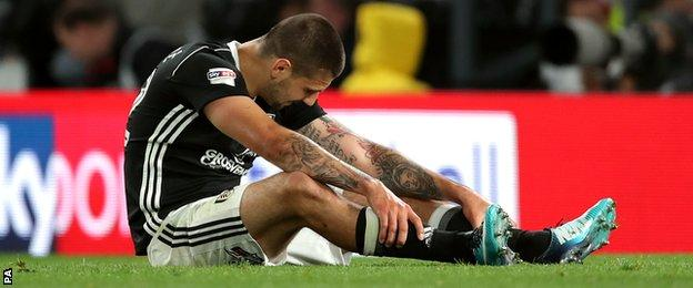 Aleksandar Mitrovic sits on the ground
